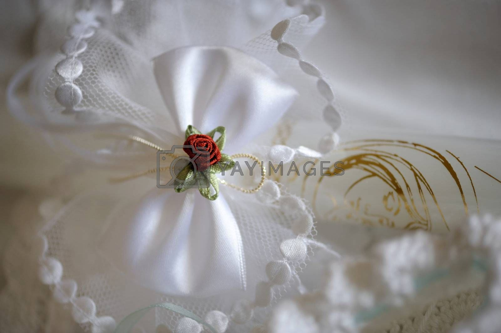 White and red wedding decoration set consisting of white candle, red flower and white rbow