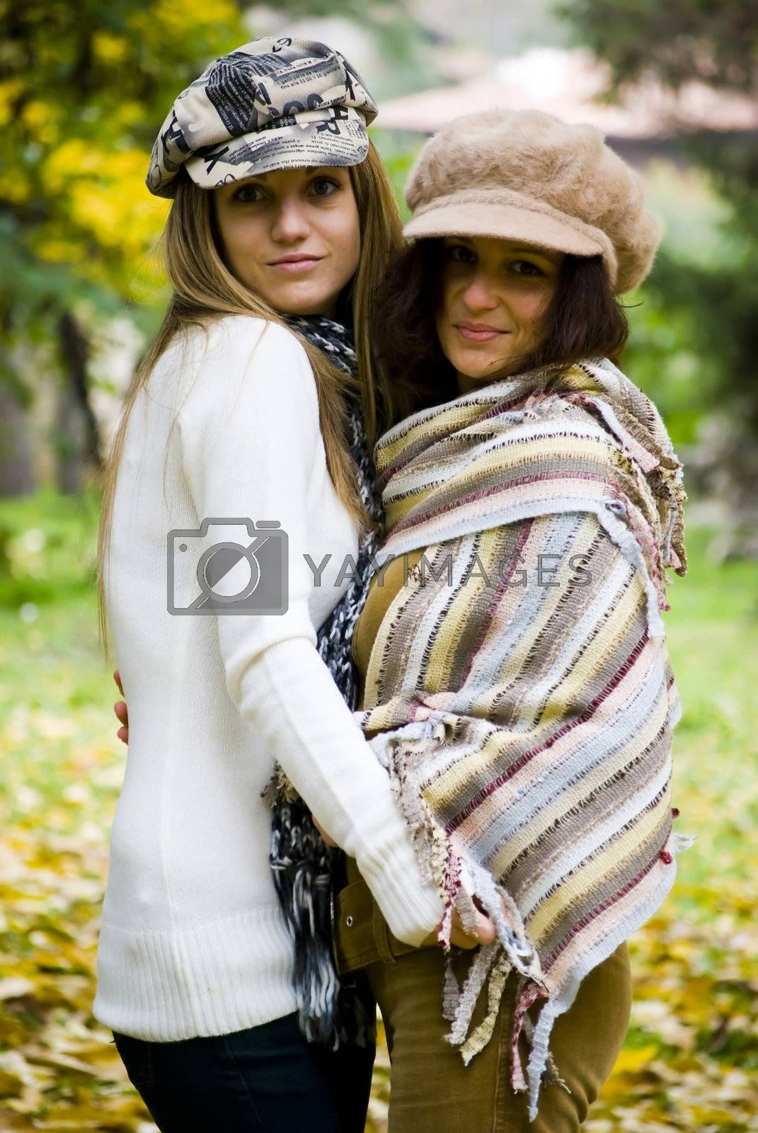 beautiful young woman outdoors portrait in autumn fashion