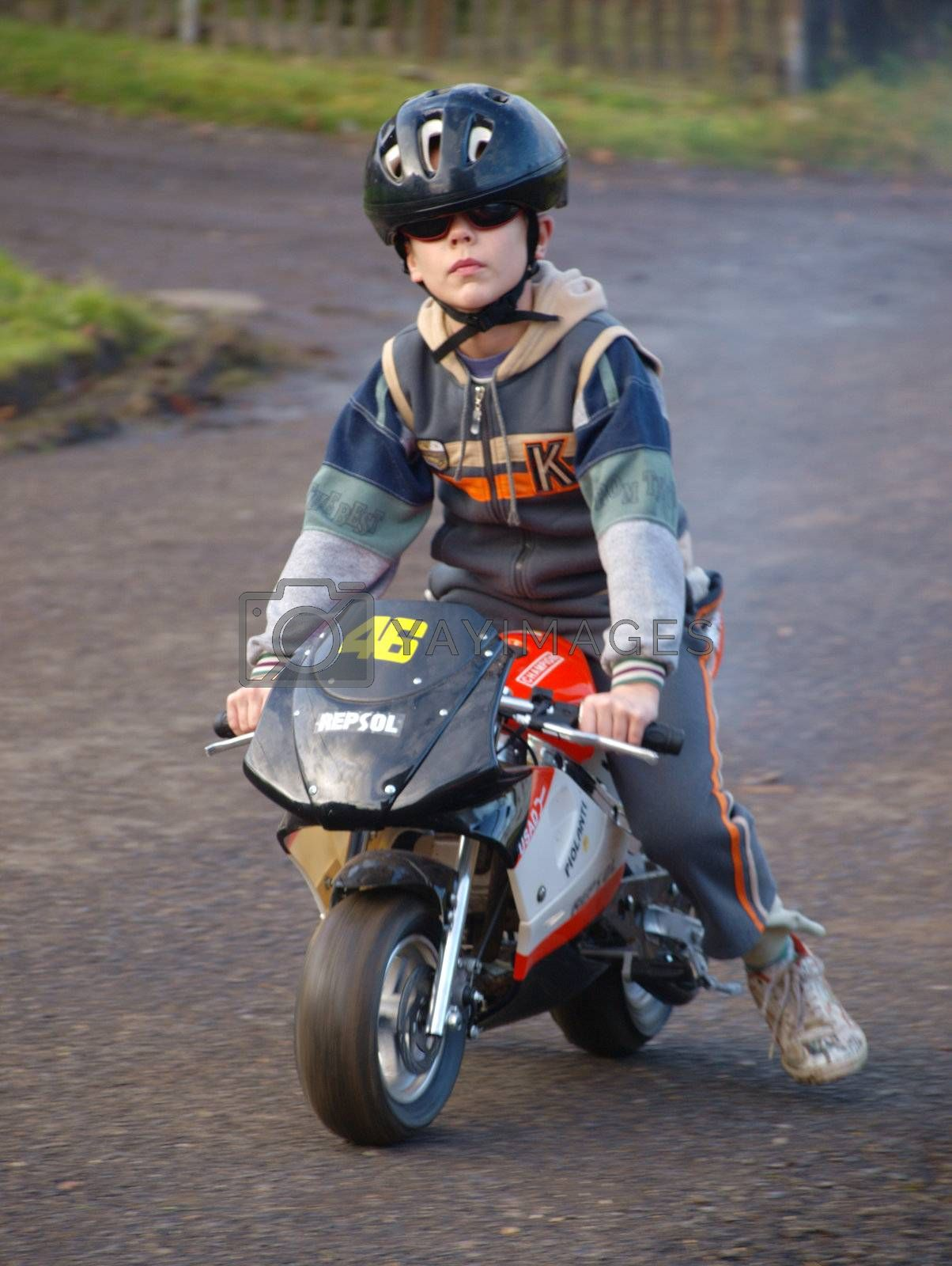 small biker on the road