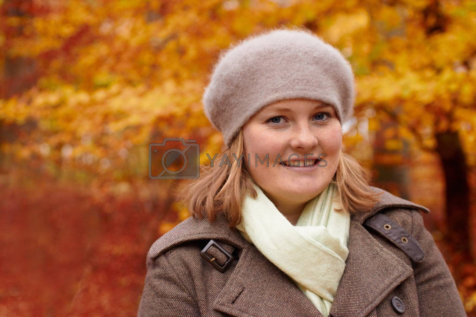 Royalty free image of Fall - Cute young woman looking at you with copyspace by FreedomImage