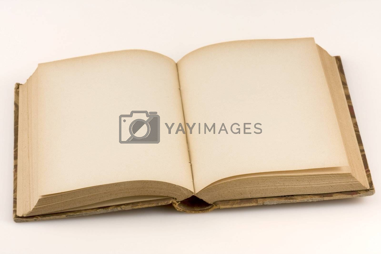 Close up shot of an open antique book, on white background