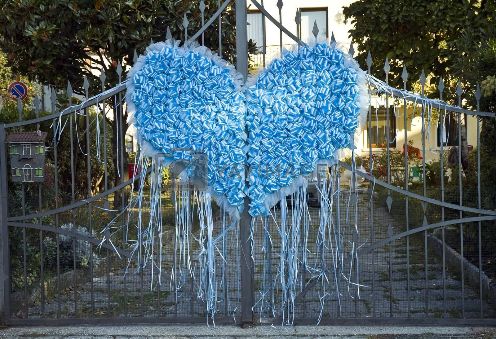heart made of blue ribbons to celebrate a birth