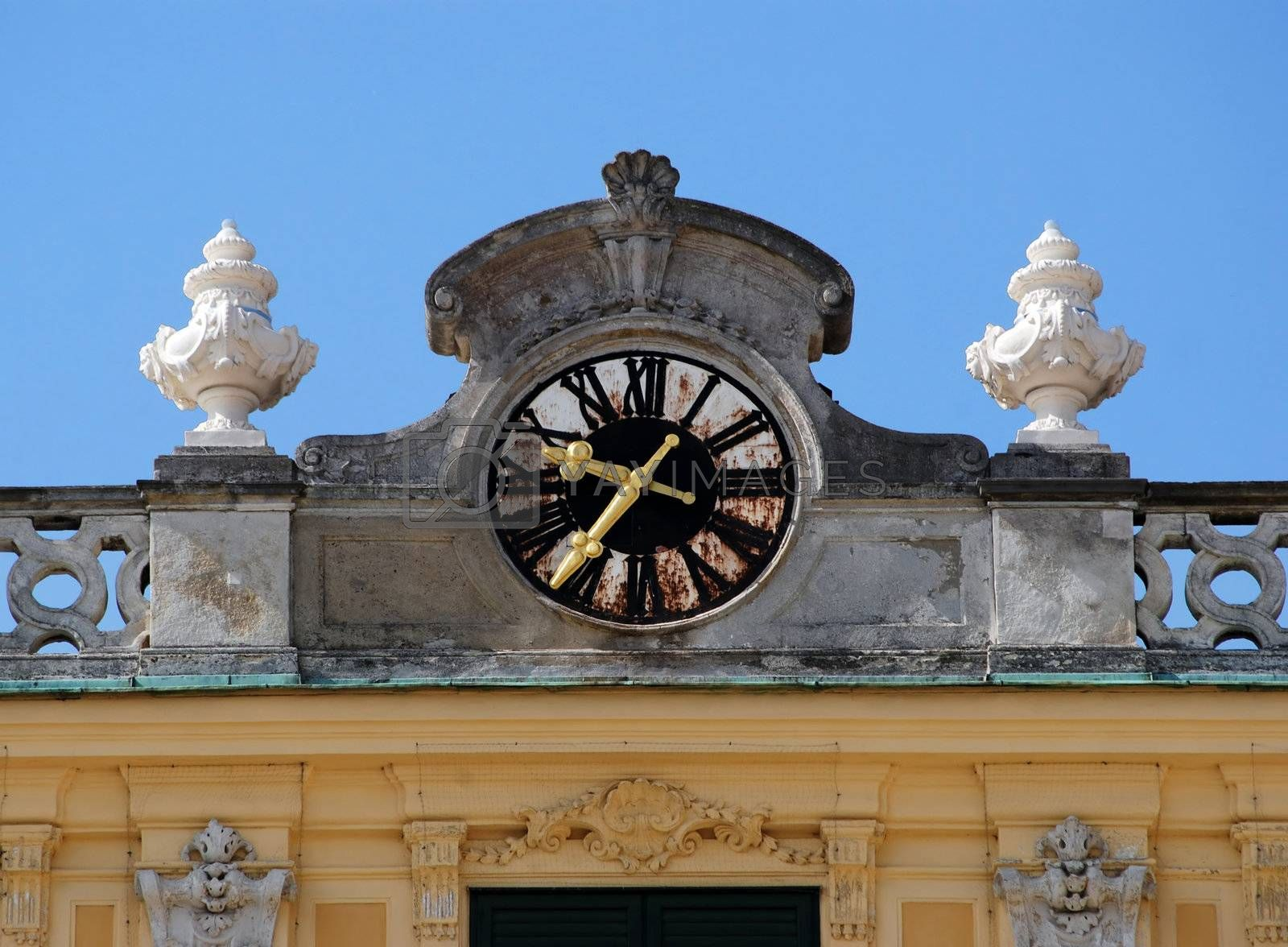 Golden clock fingers at schonbrunn vienna
