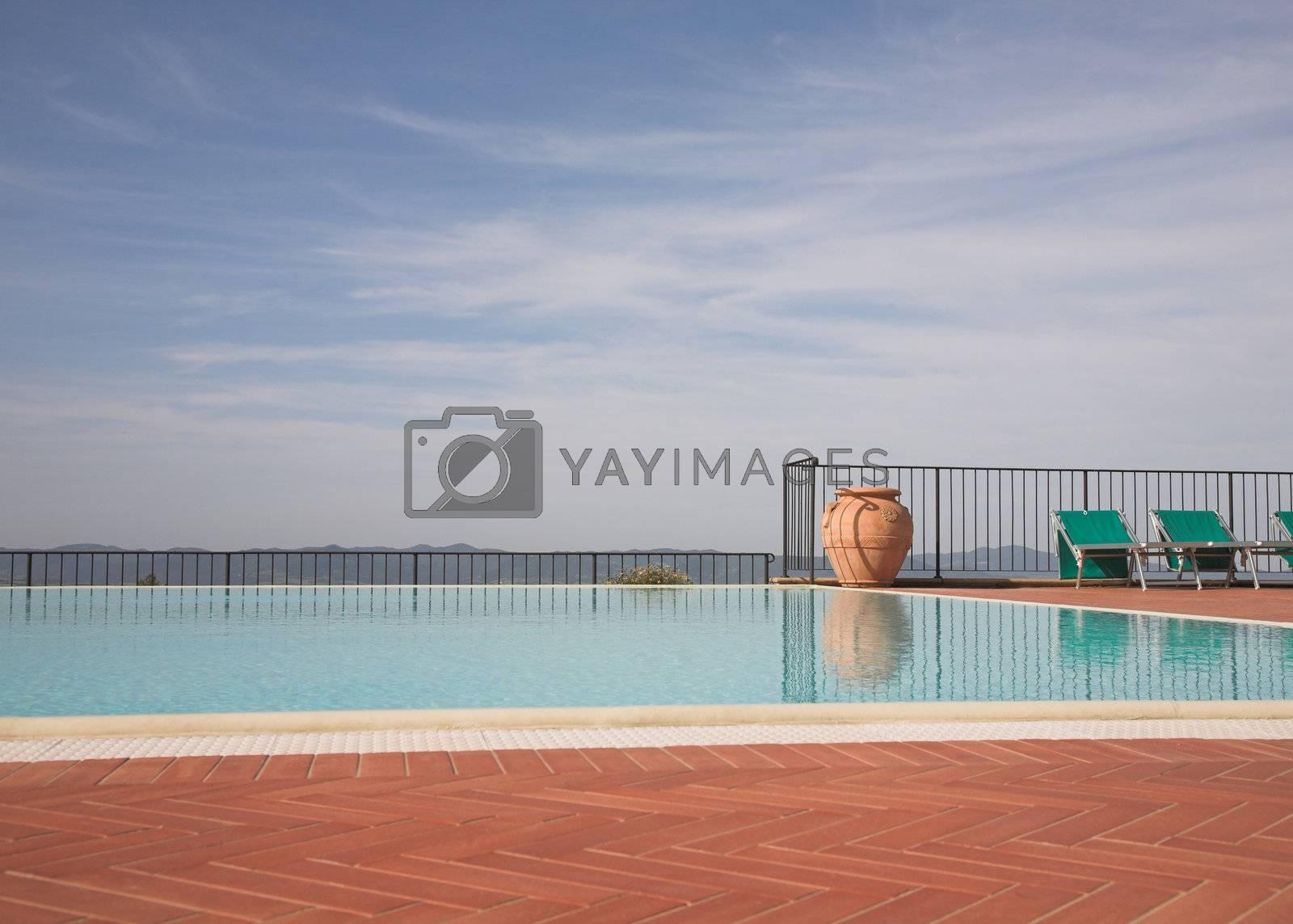 Luxury outdoor swimming pool overlooking distant hills.
