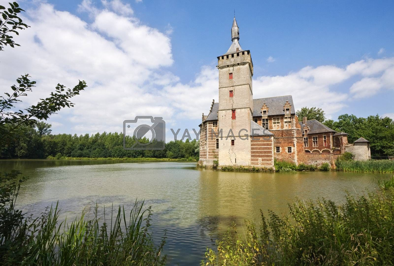 View at castle Horst in Belgium surrounded by pond and woods