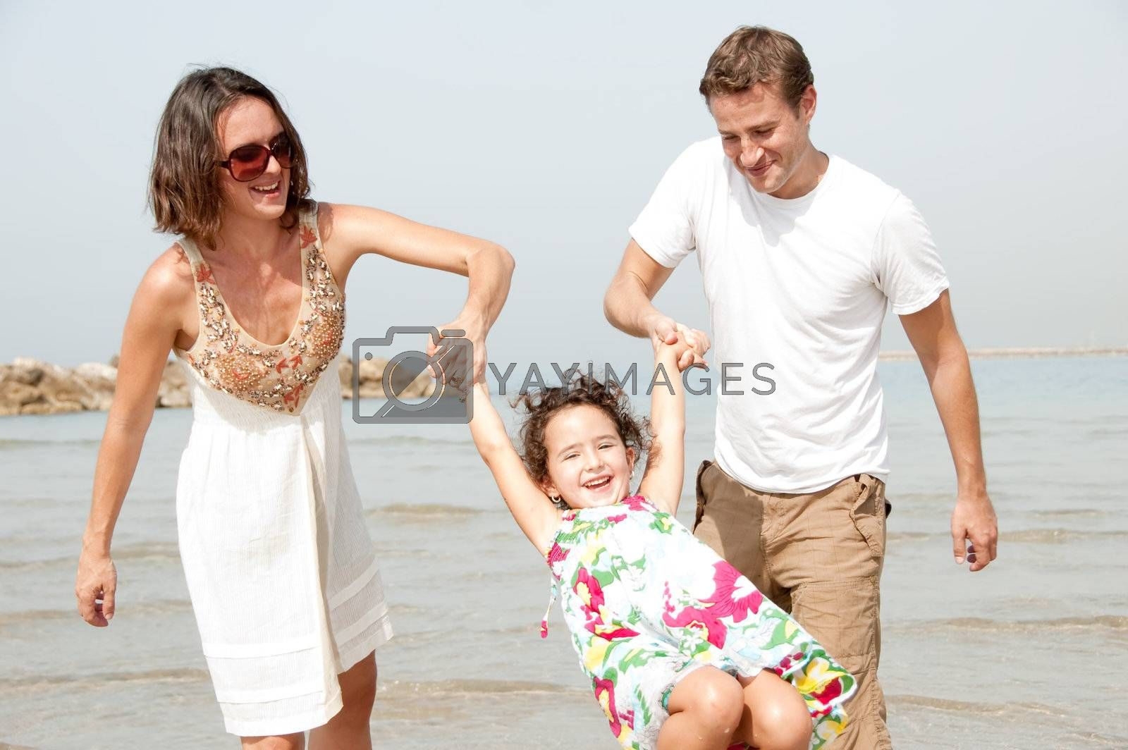 father and mother hold the daughter by get4net