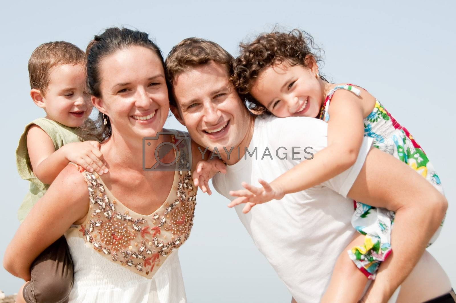 family in the beach by get4net