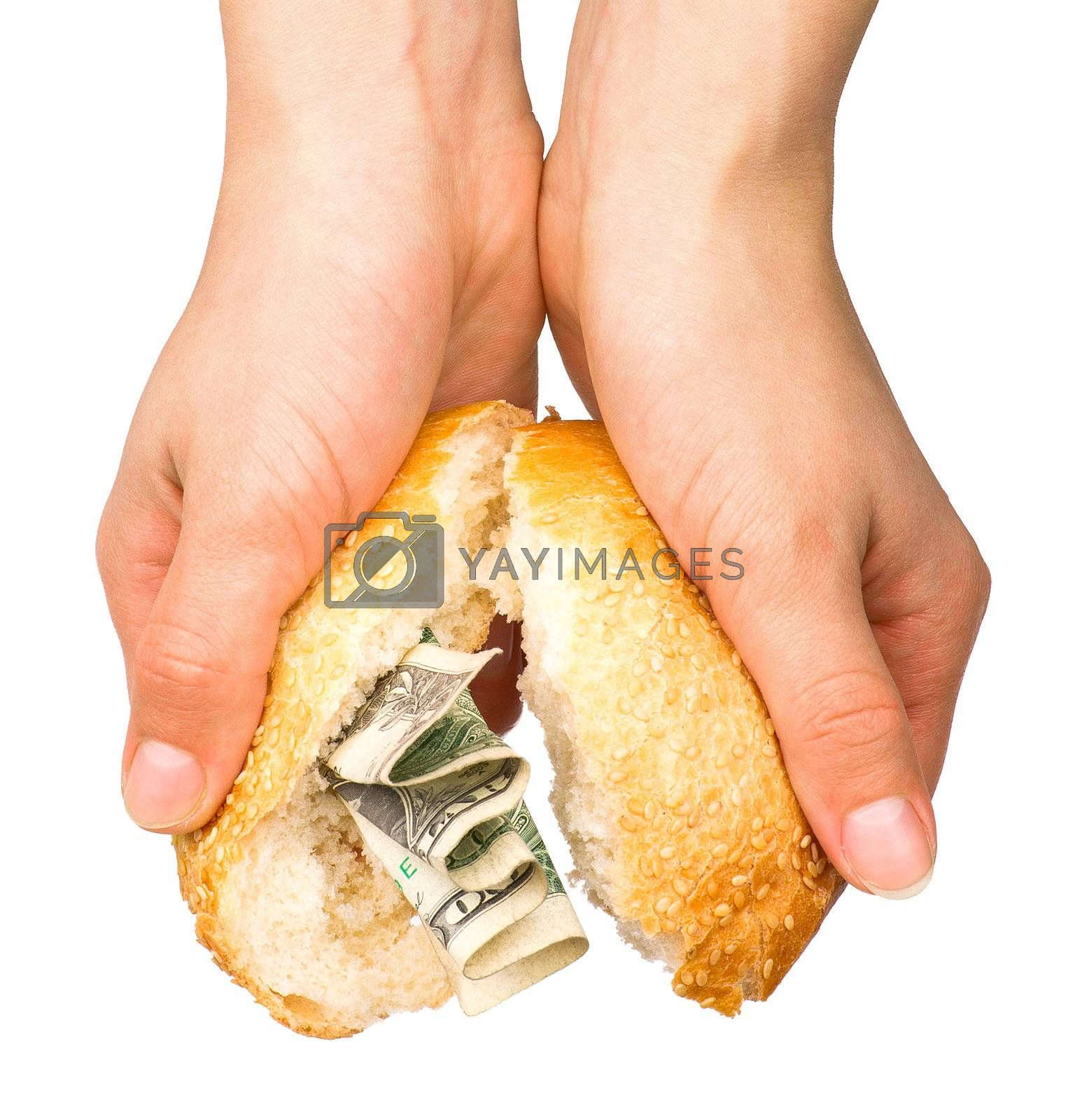 Hands holding the bun stuffed with money