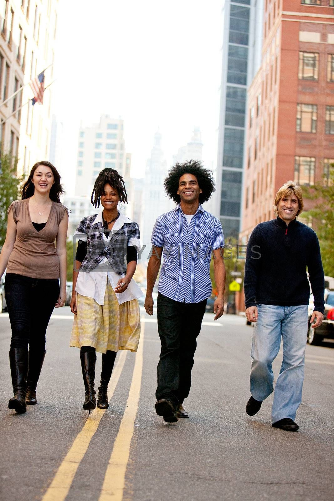 A group of young adults in the city on a street