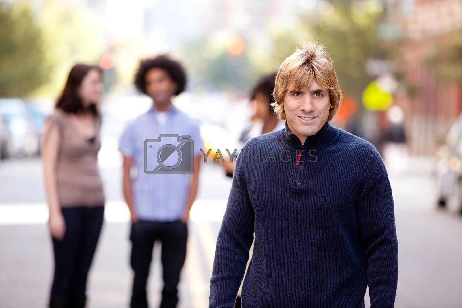 A group of people in a city setting - a caucasian male in the foreground