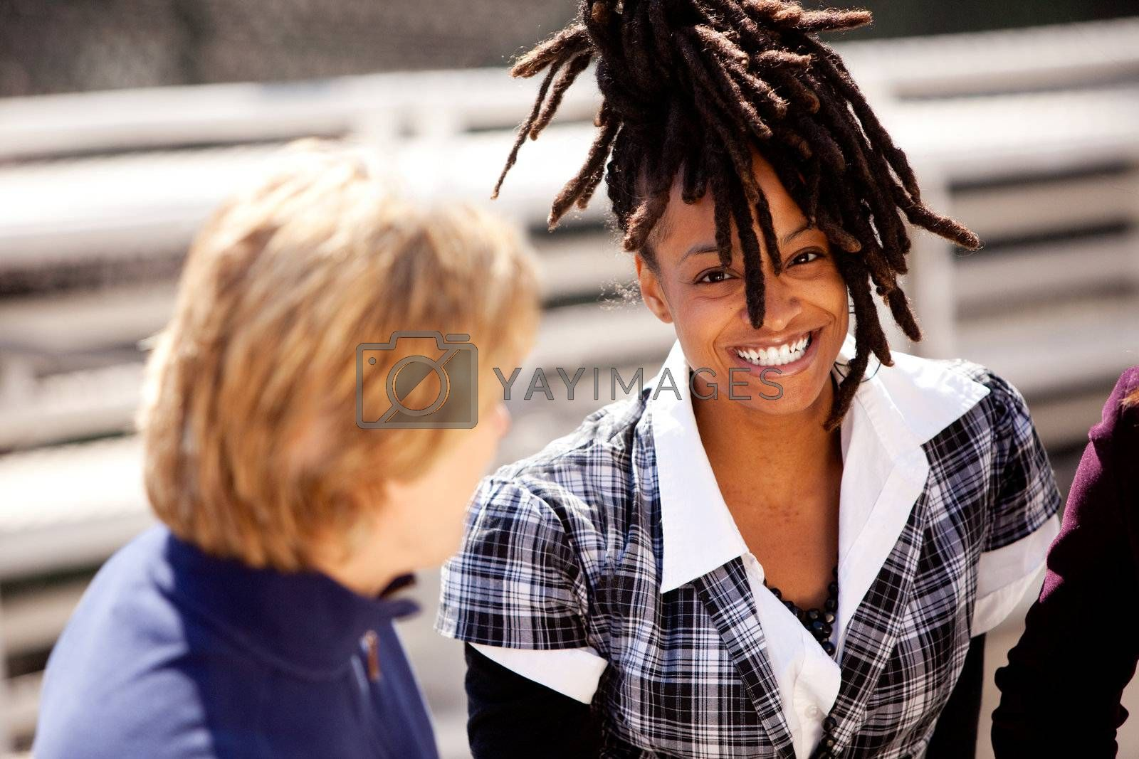 A casual portrait of a beautiful african american with a big smile