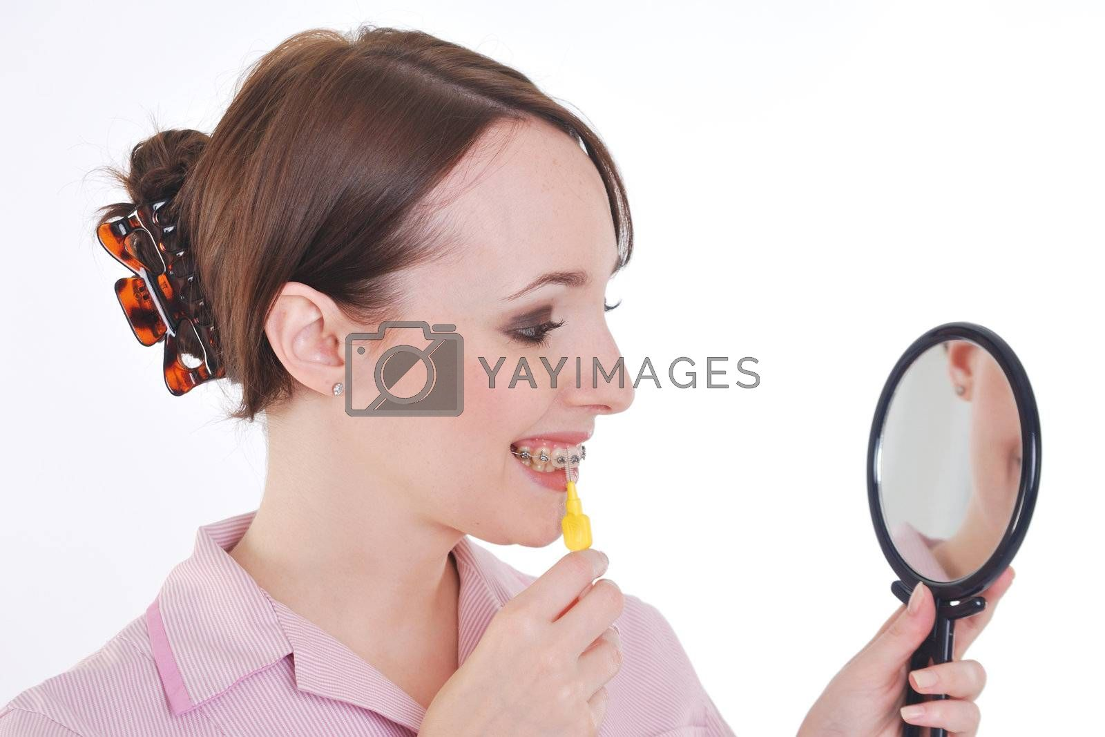 Dental hygenist demonstrating tooth cleaning