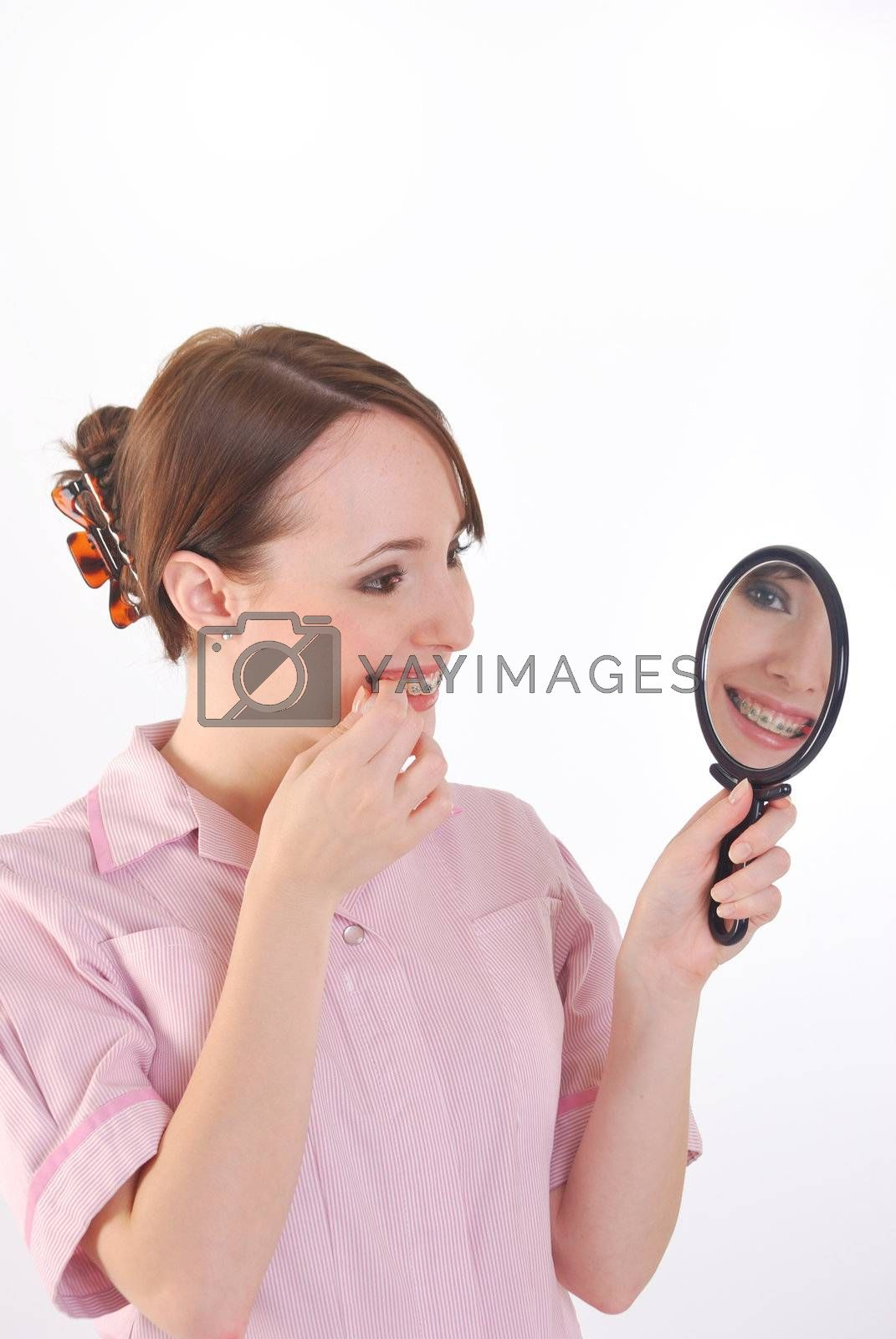 girl with braces cleaning teeth