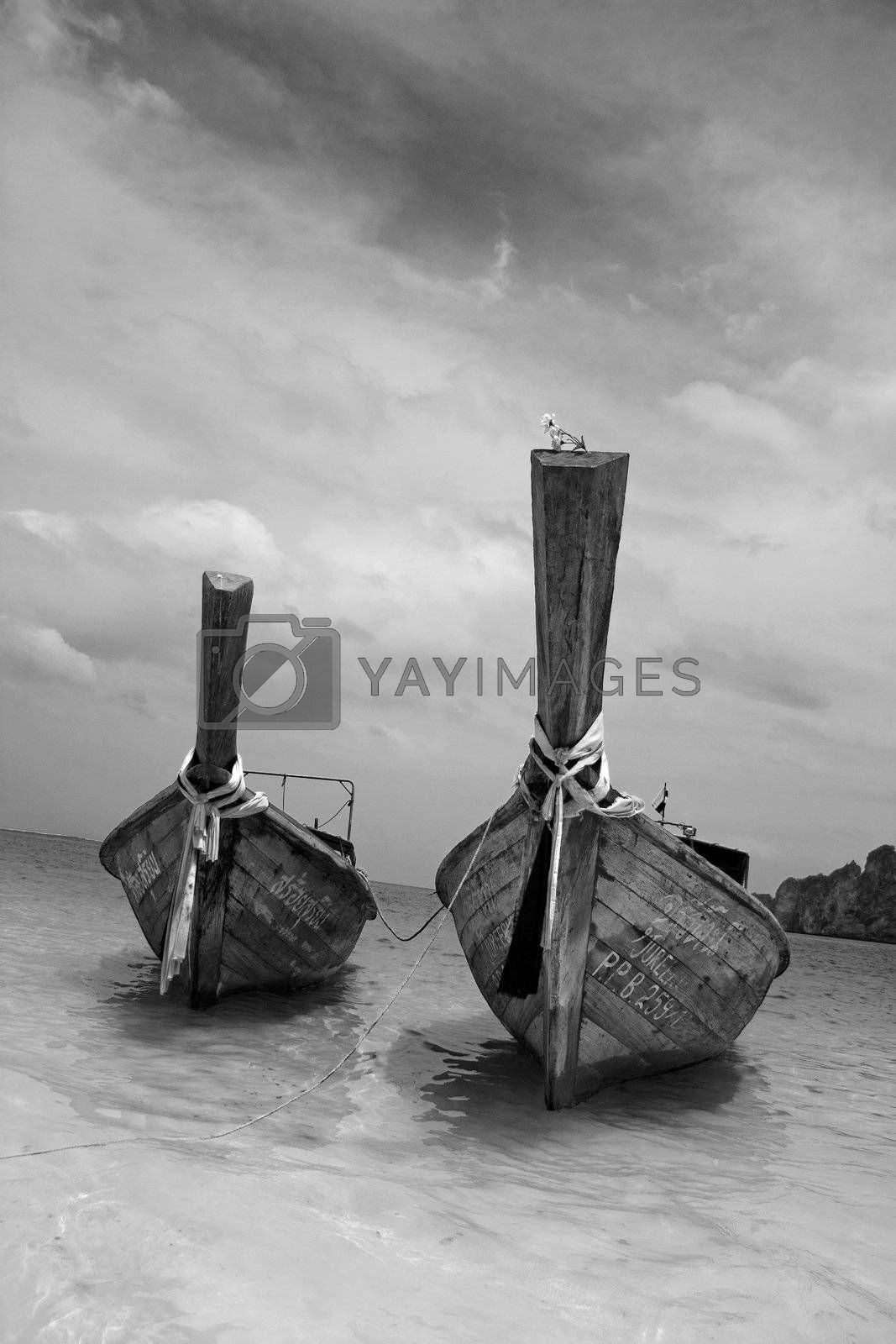 Longtailboat tied up at the beach in Thailand