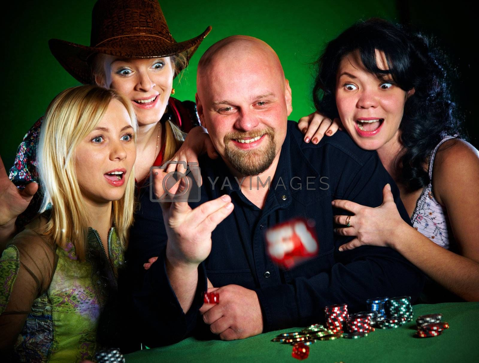 company of friends plays dice...