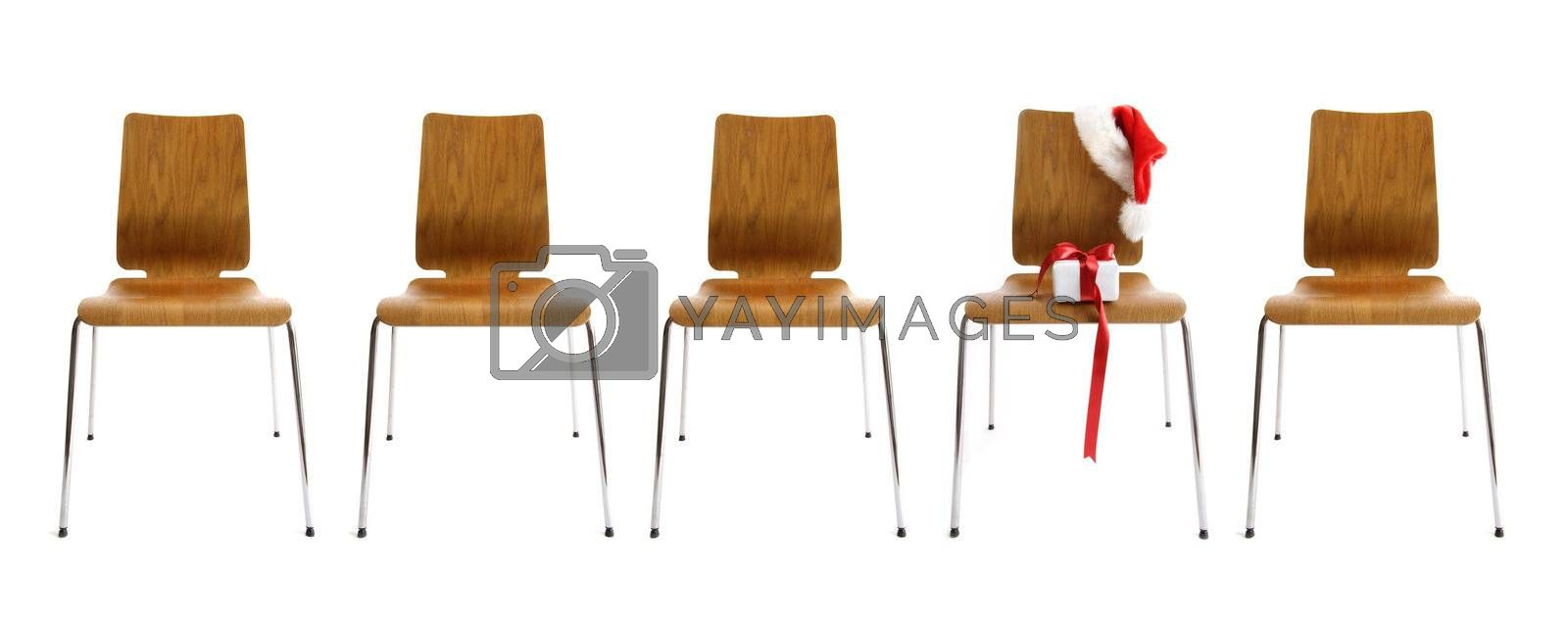 Chairs in a row with gift on white background