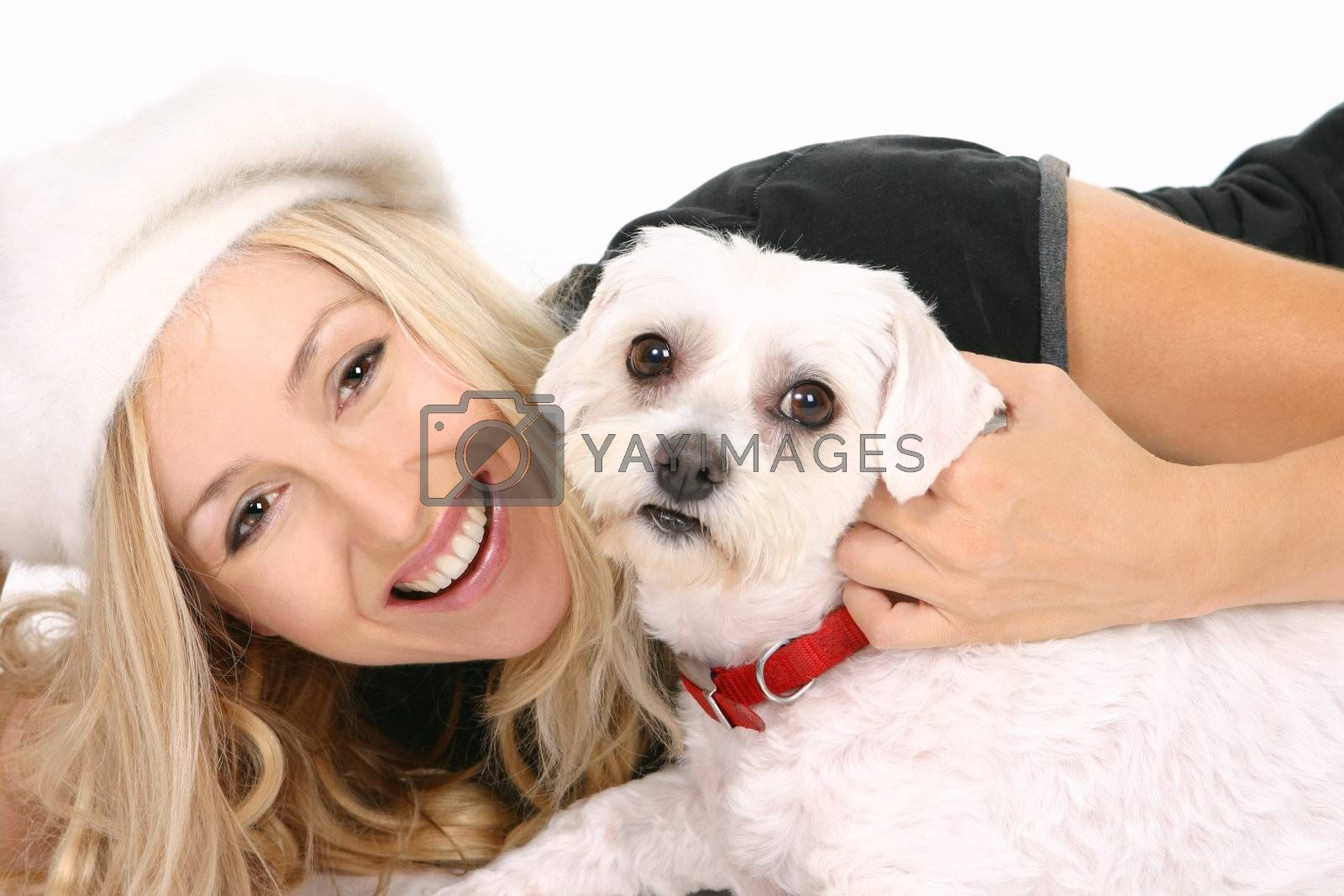 Cheerful female playing with a dog.