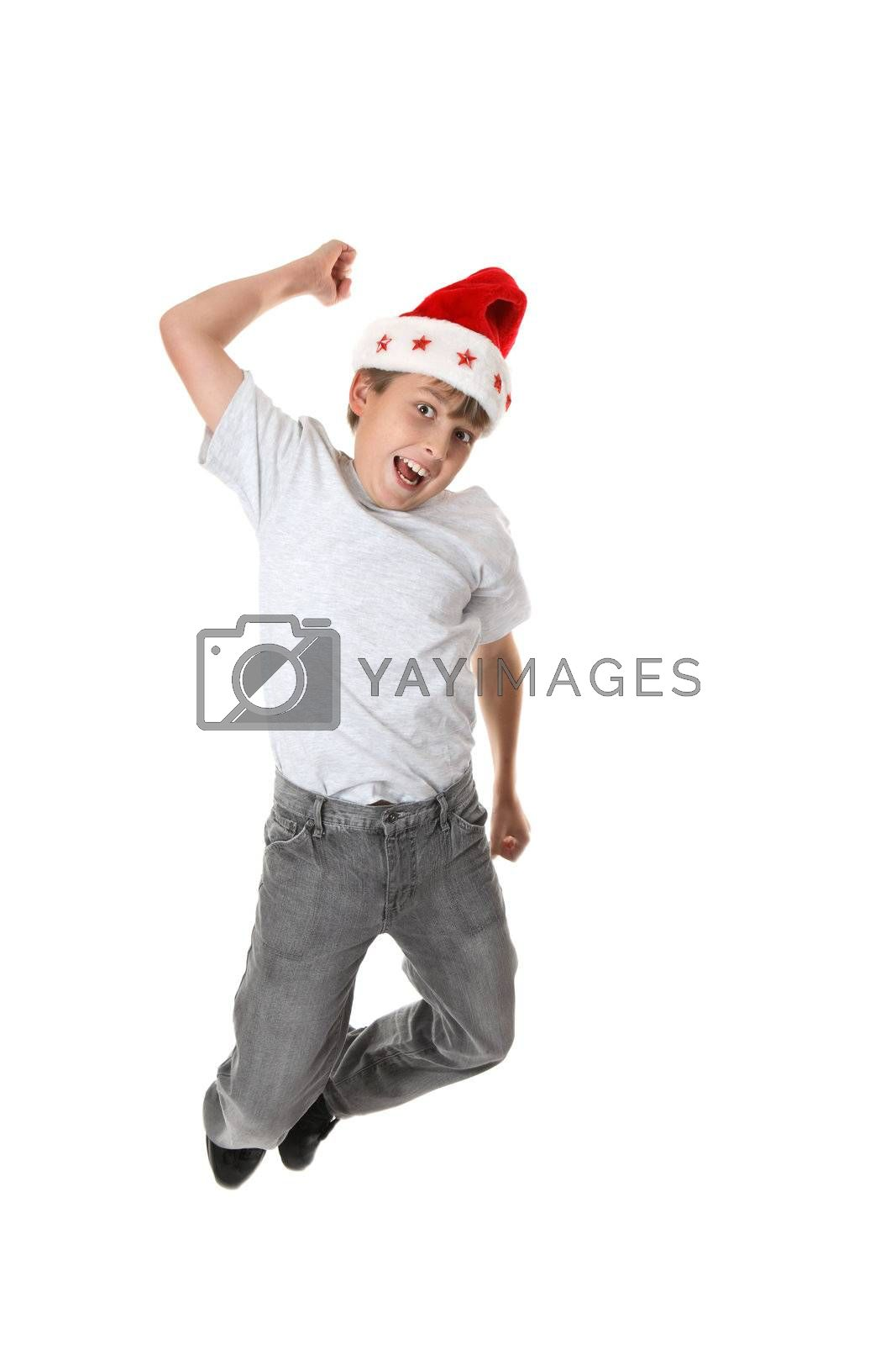 A child leaping into the air in celebration of Christmas