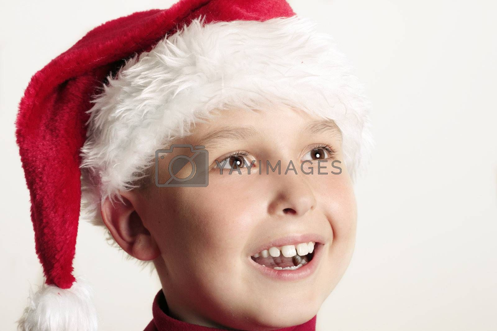 An excited boy enjoying Christmas festivities.  closeup