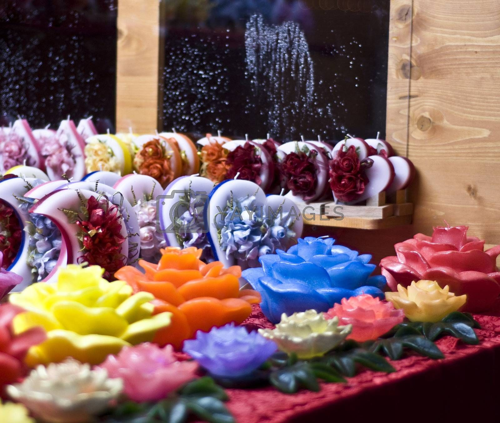 decorative candles in the shape of multicolored roses and heart