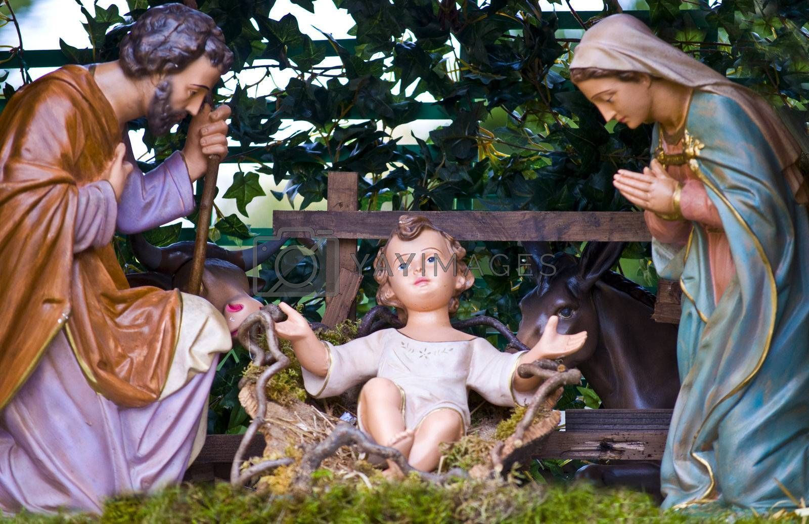 statues of the Holy Family in a crib