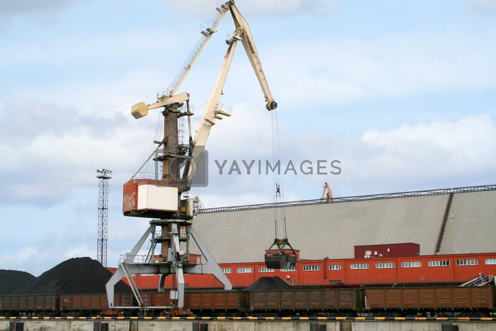 Container cranes for loading and unloading freight trains in Latvian port