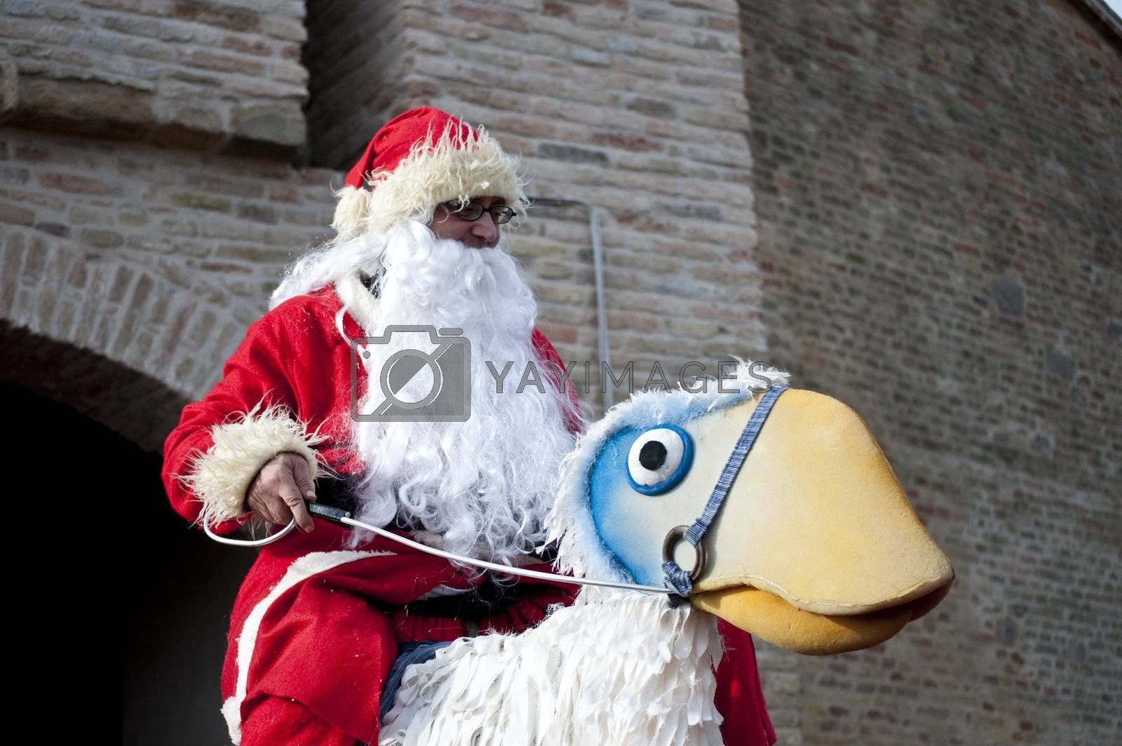 Santa Claus riding a fake ostrich.