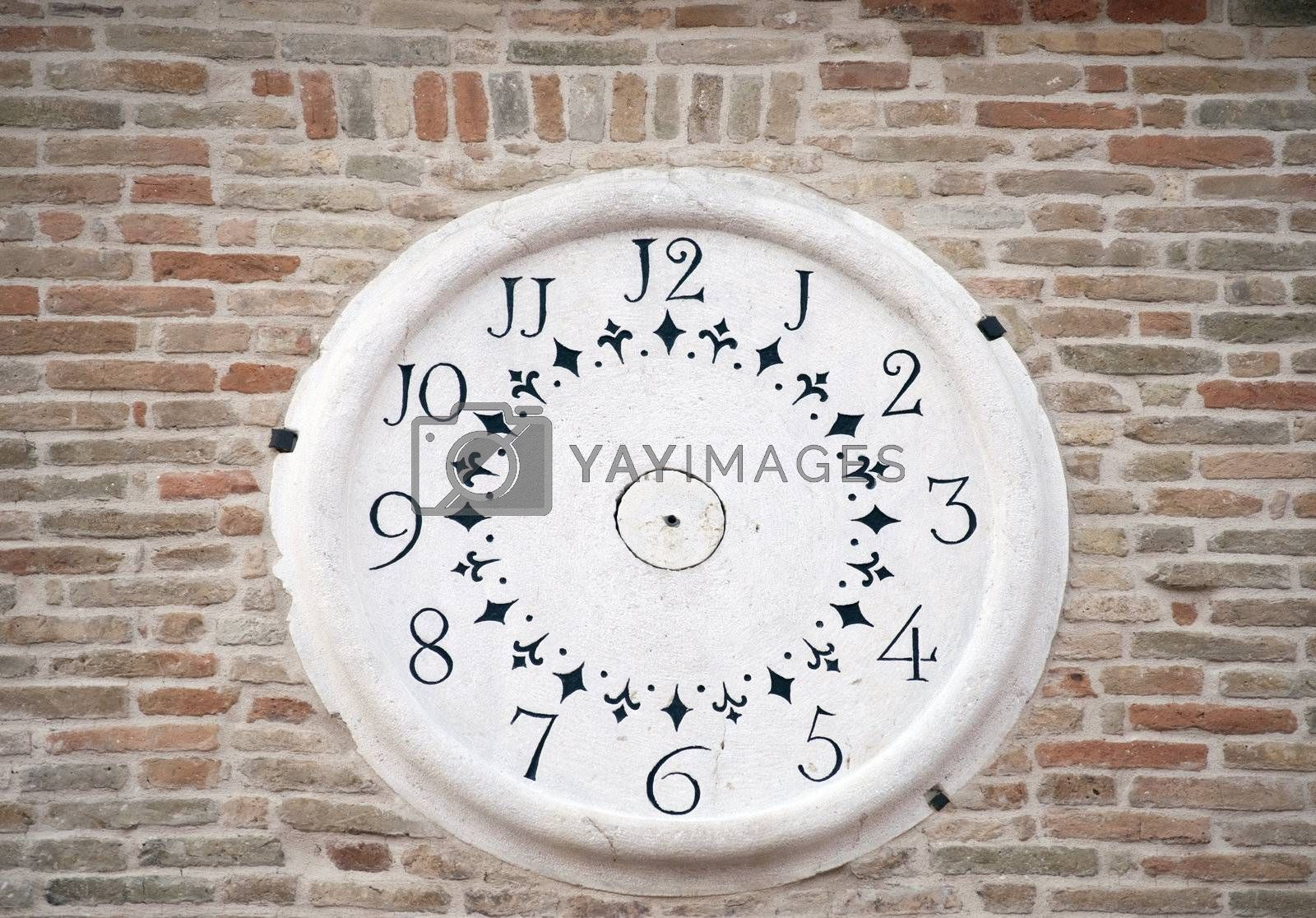 Wall Clock on the facade of an ancient construction.