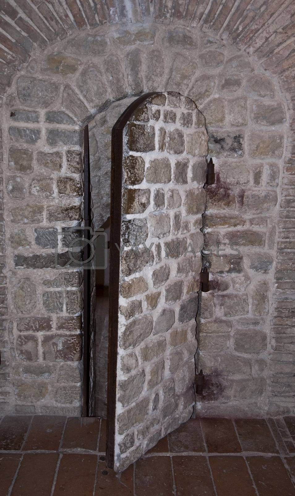Old door covered with stones in a fortress