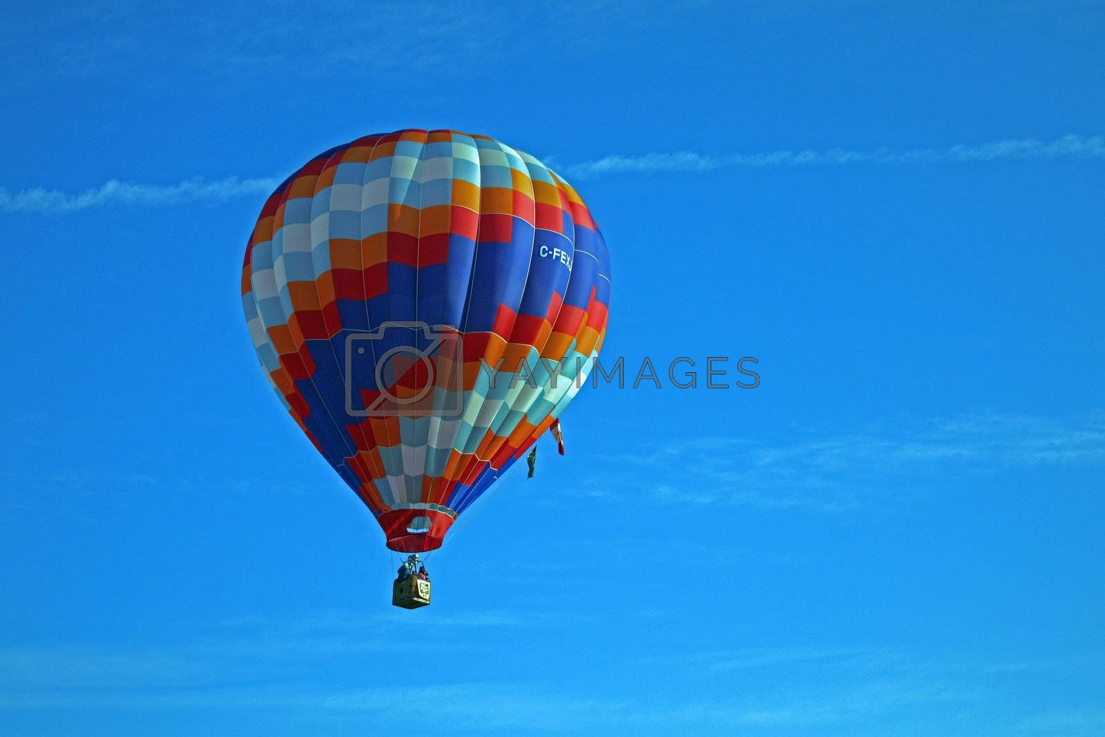 Hot air balloon on blue background with red blue and white highlights.