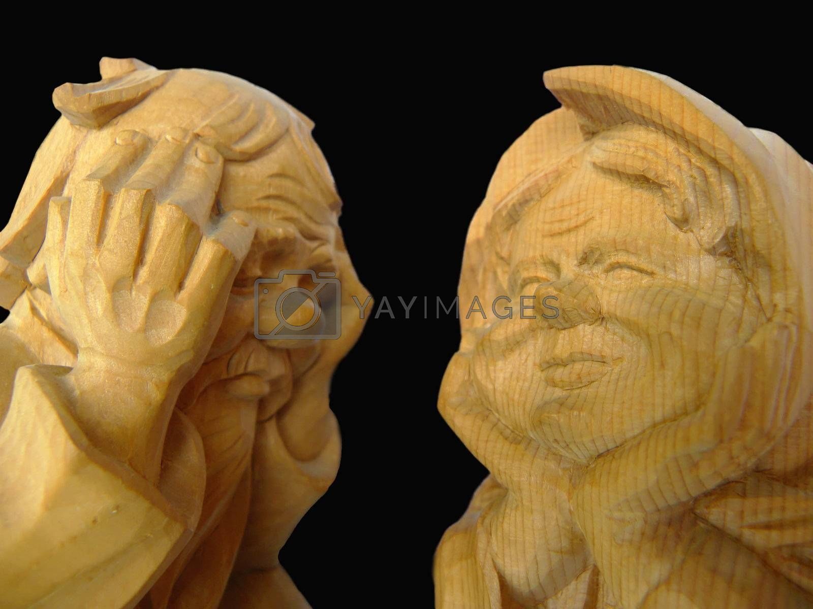 two wooden statues of elderly