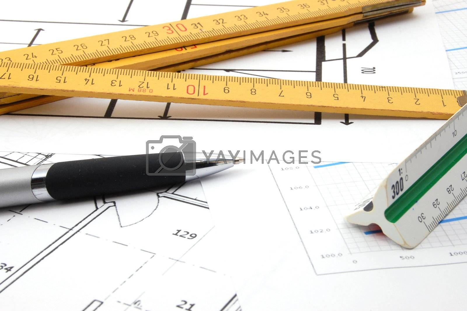 architecture or business still life with plans as background