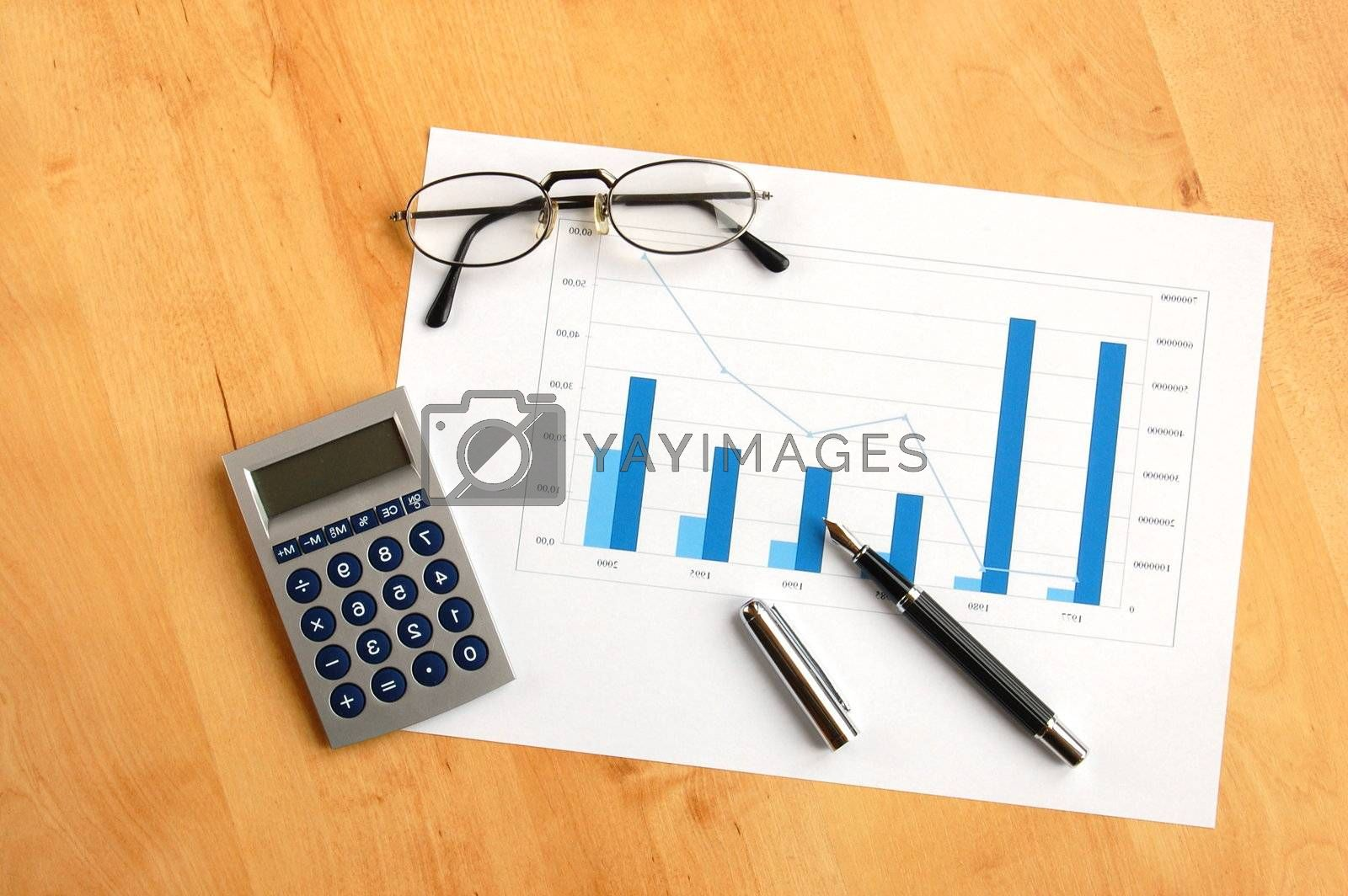 business still life with coffee and chart showing success