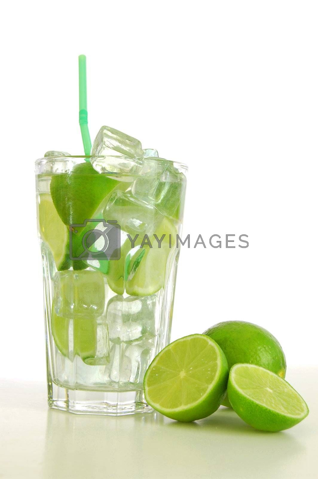 Caipirinha cocktail with green lemon and ice cubes