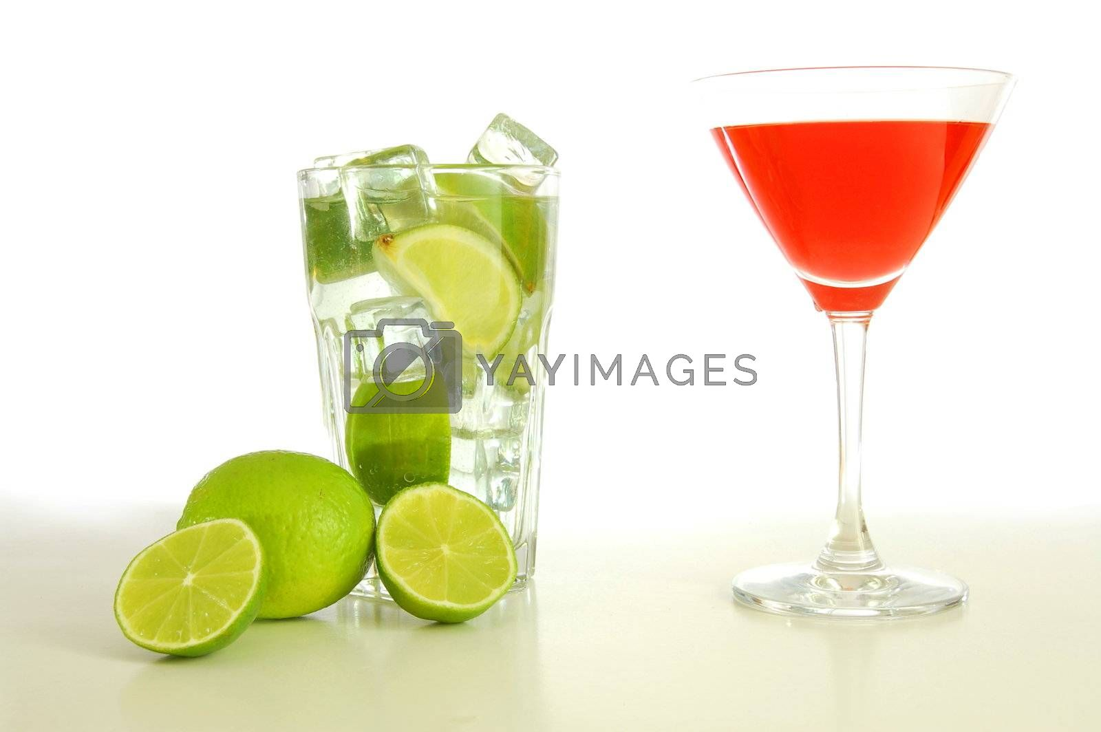 red and cold alcoholic drink with green lime
