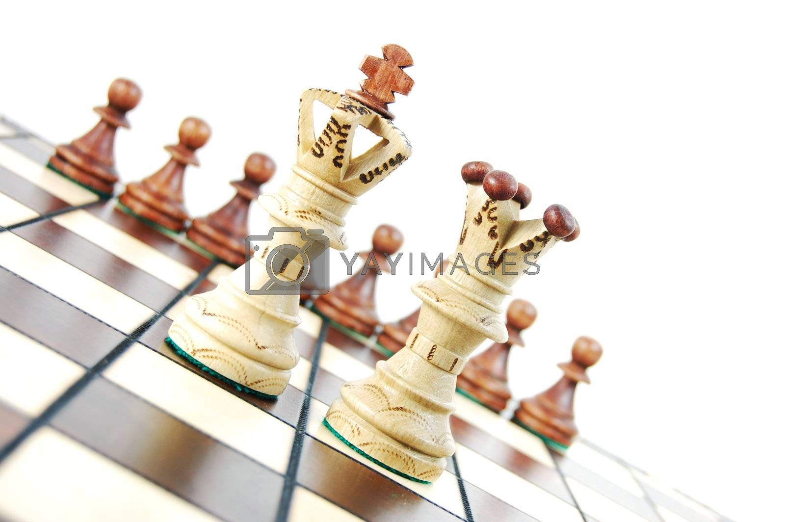 chess pieces on chess board showing concept for success and power