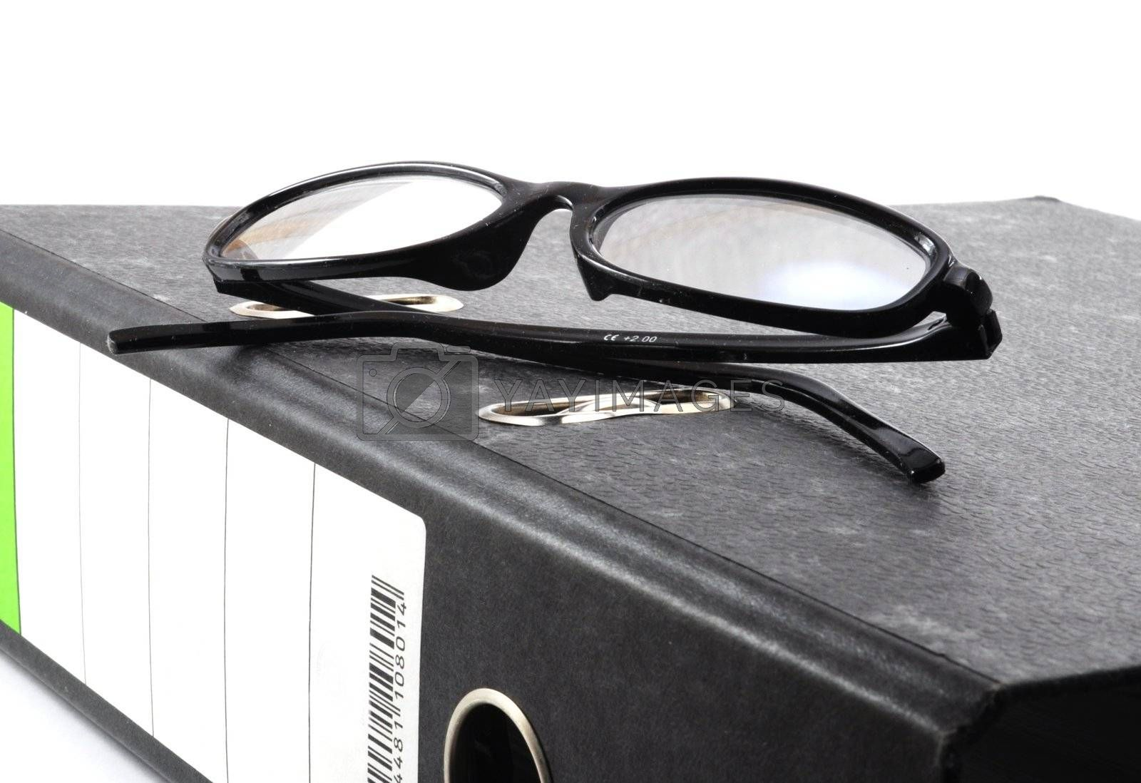 eye glasses and folder in the office showing paperwork concept