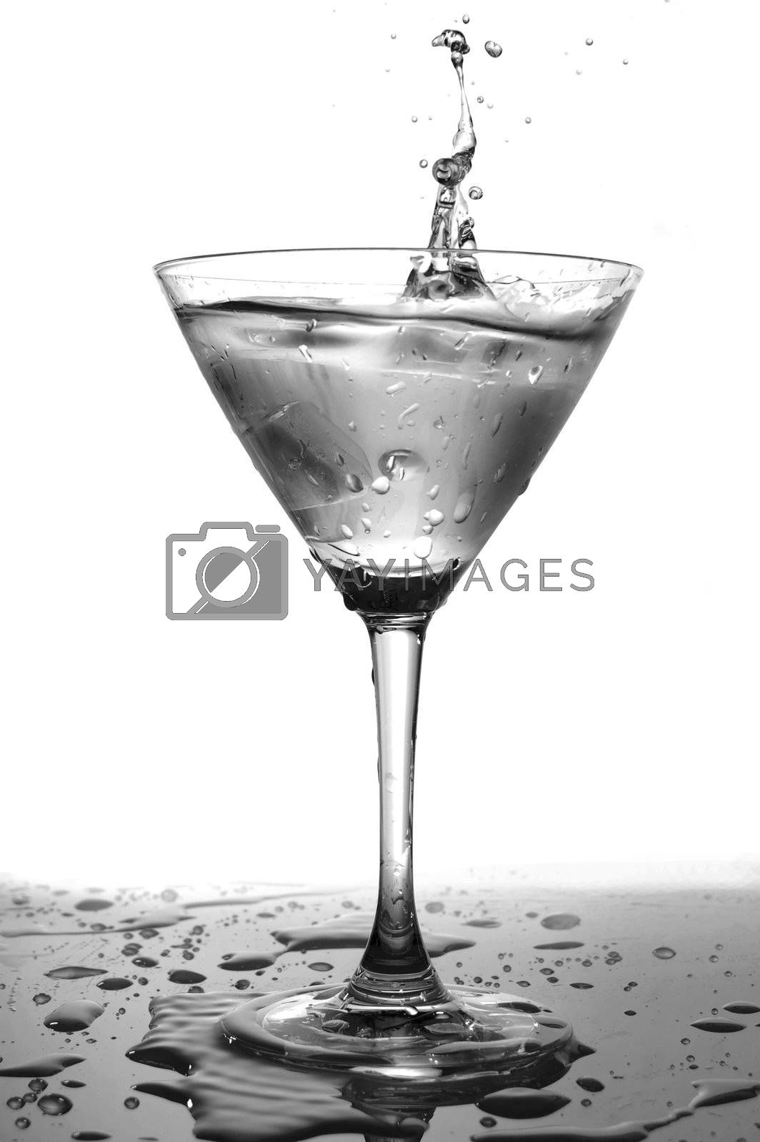 glass of cool splashing water isolated on white background