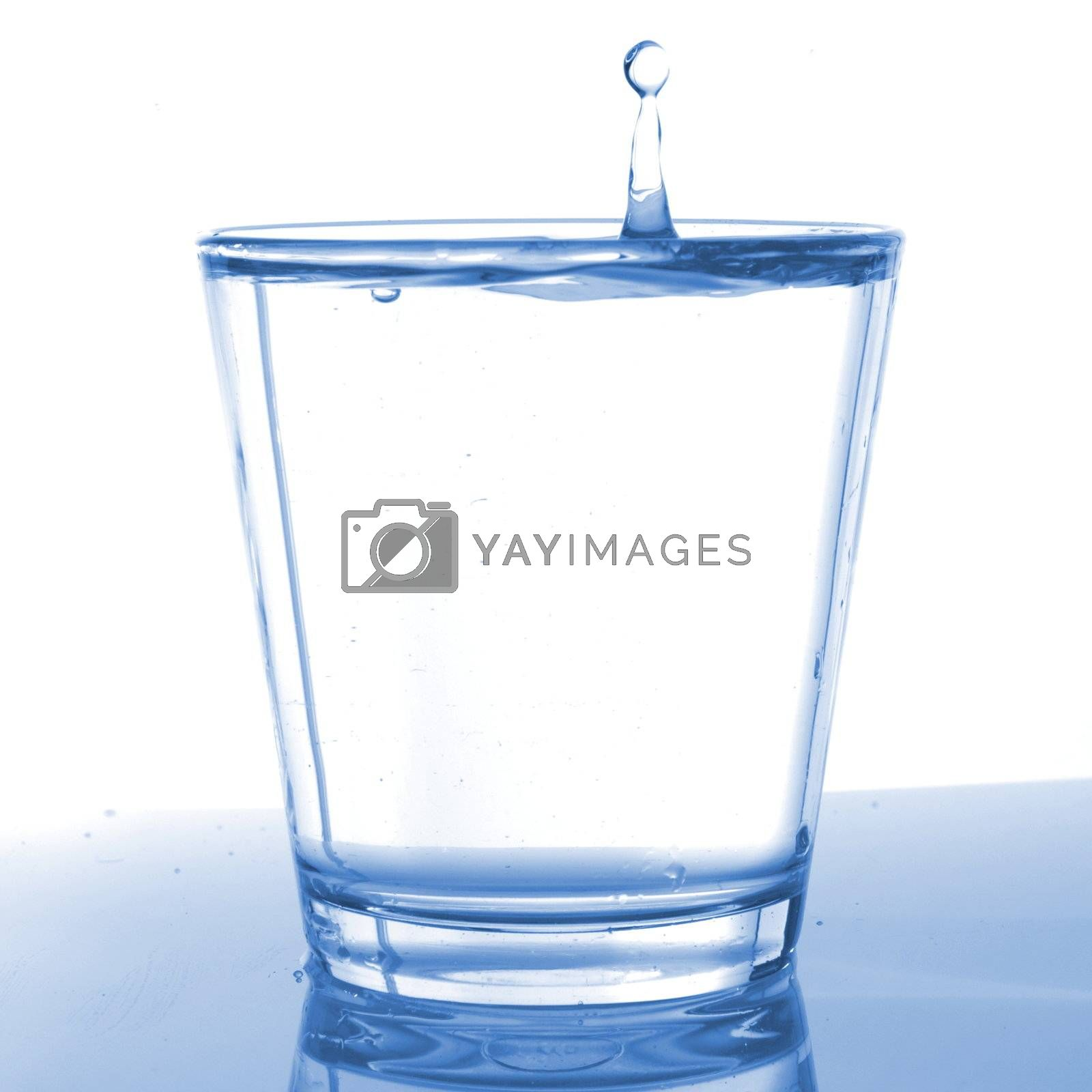 food and beverage concept with glass of pouring water