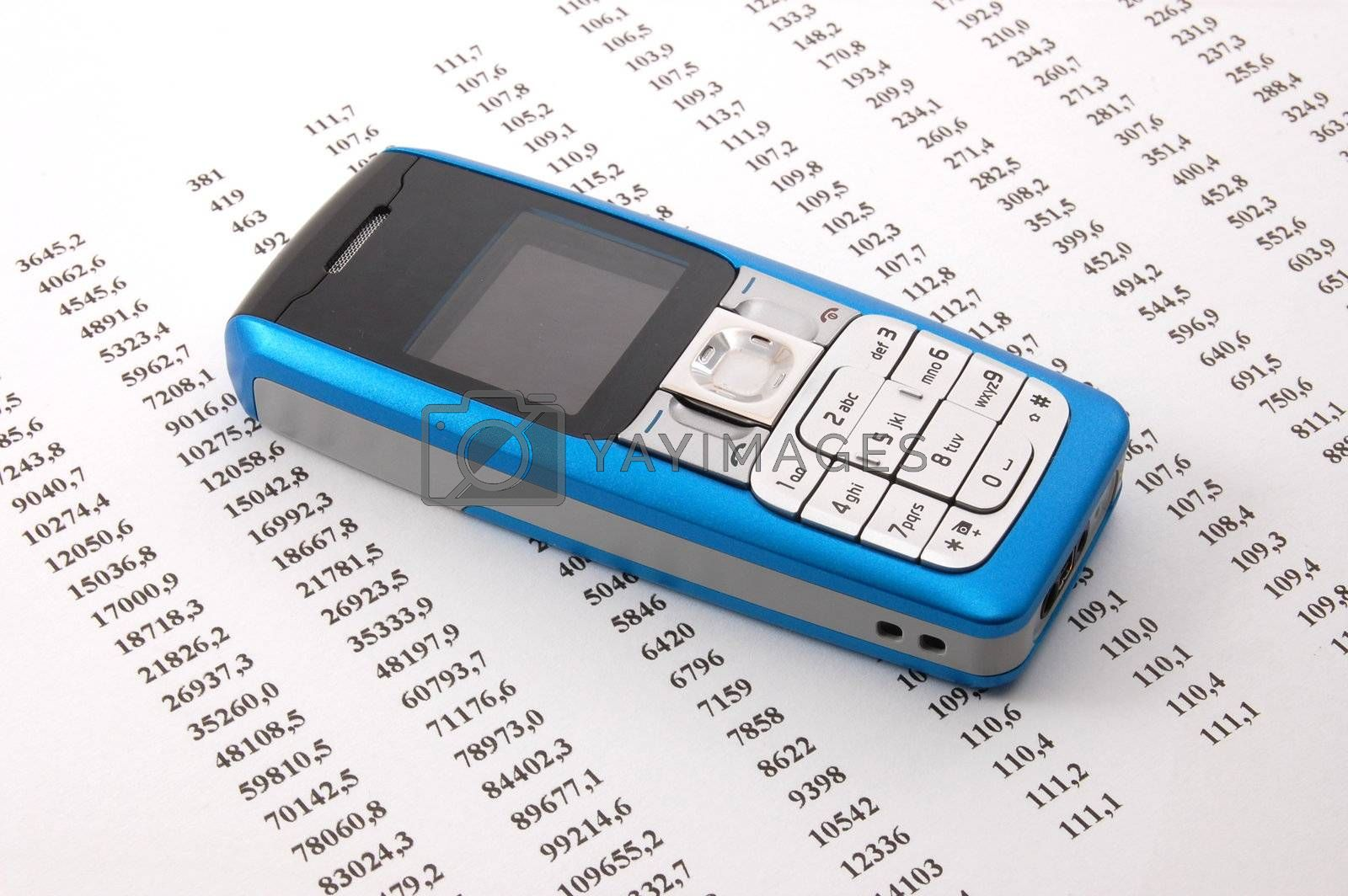 blue cell phone over business chart showing success