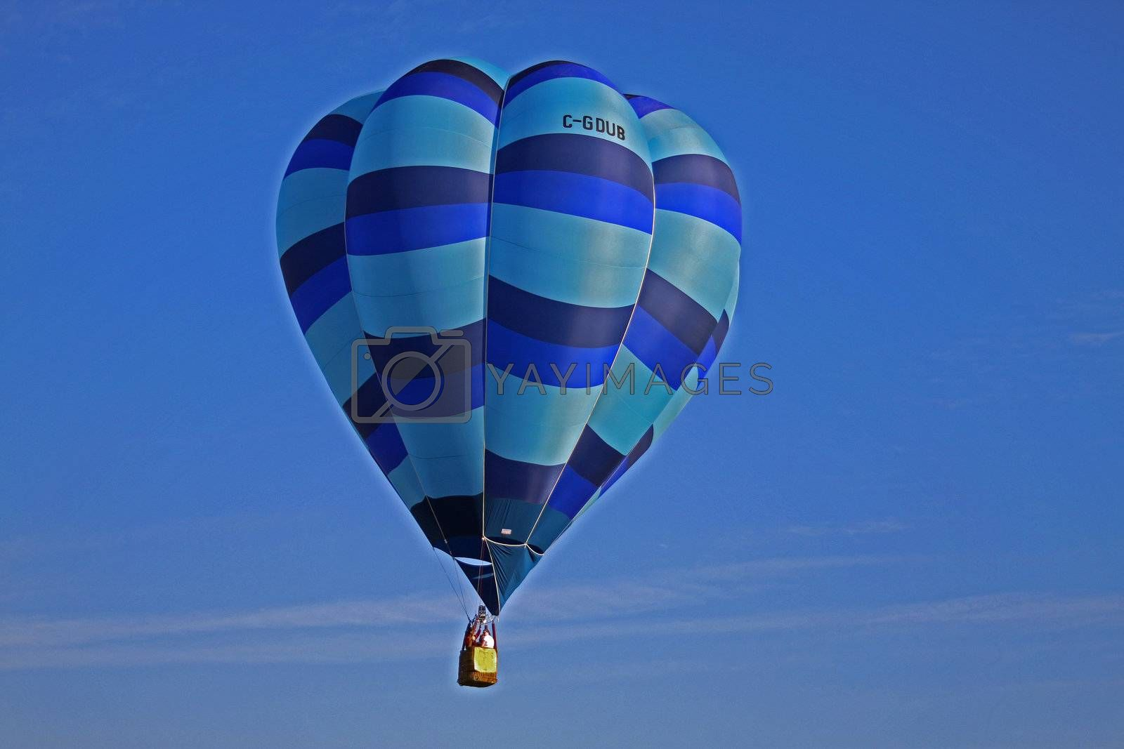 Striped blue hot air balloon on blue sky background