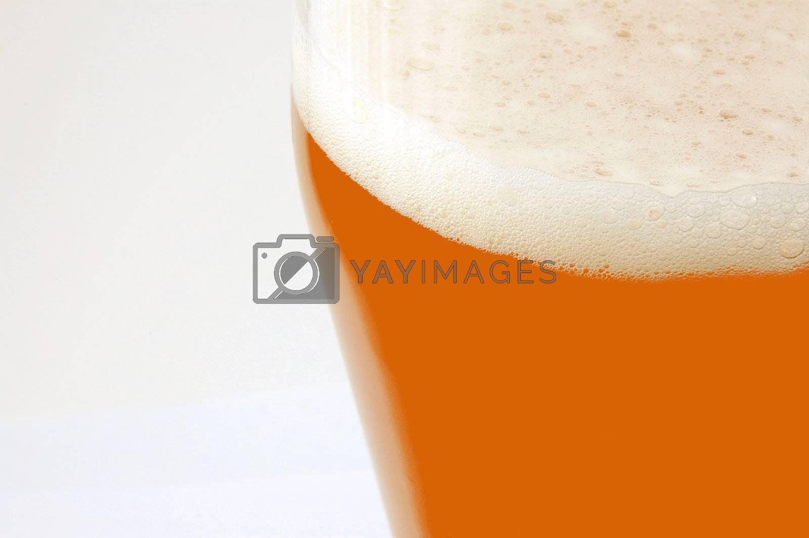glass of german beer  with foam foam and bubbles