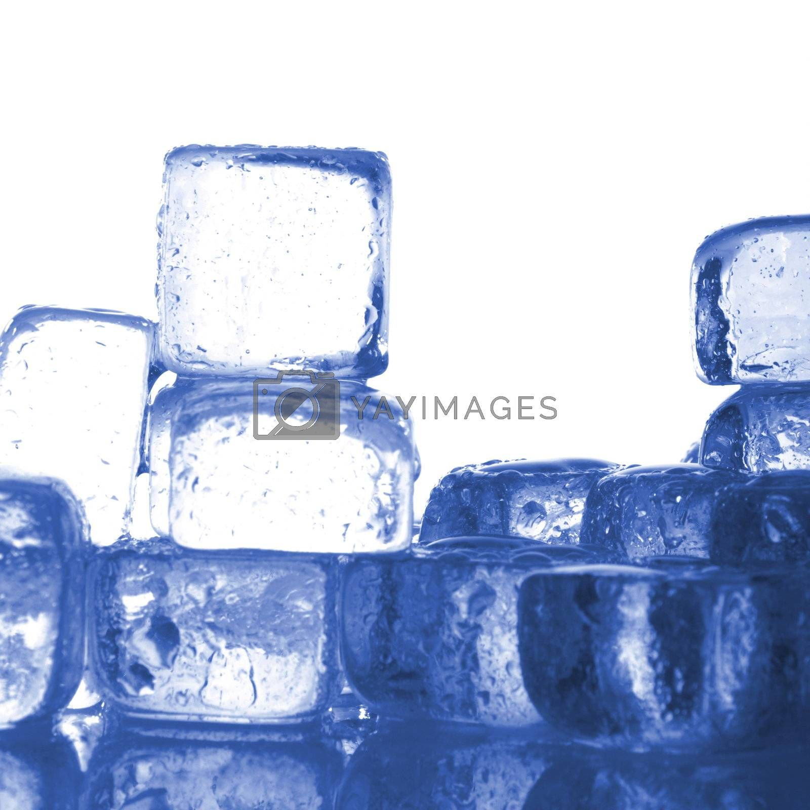blue ice cubes with water drops melting