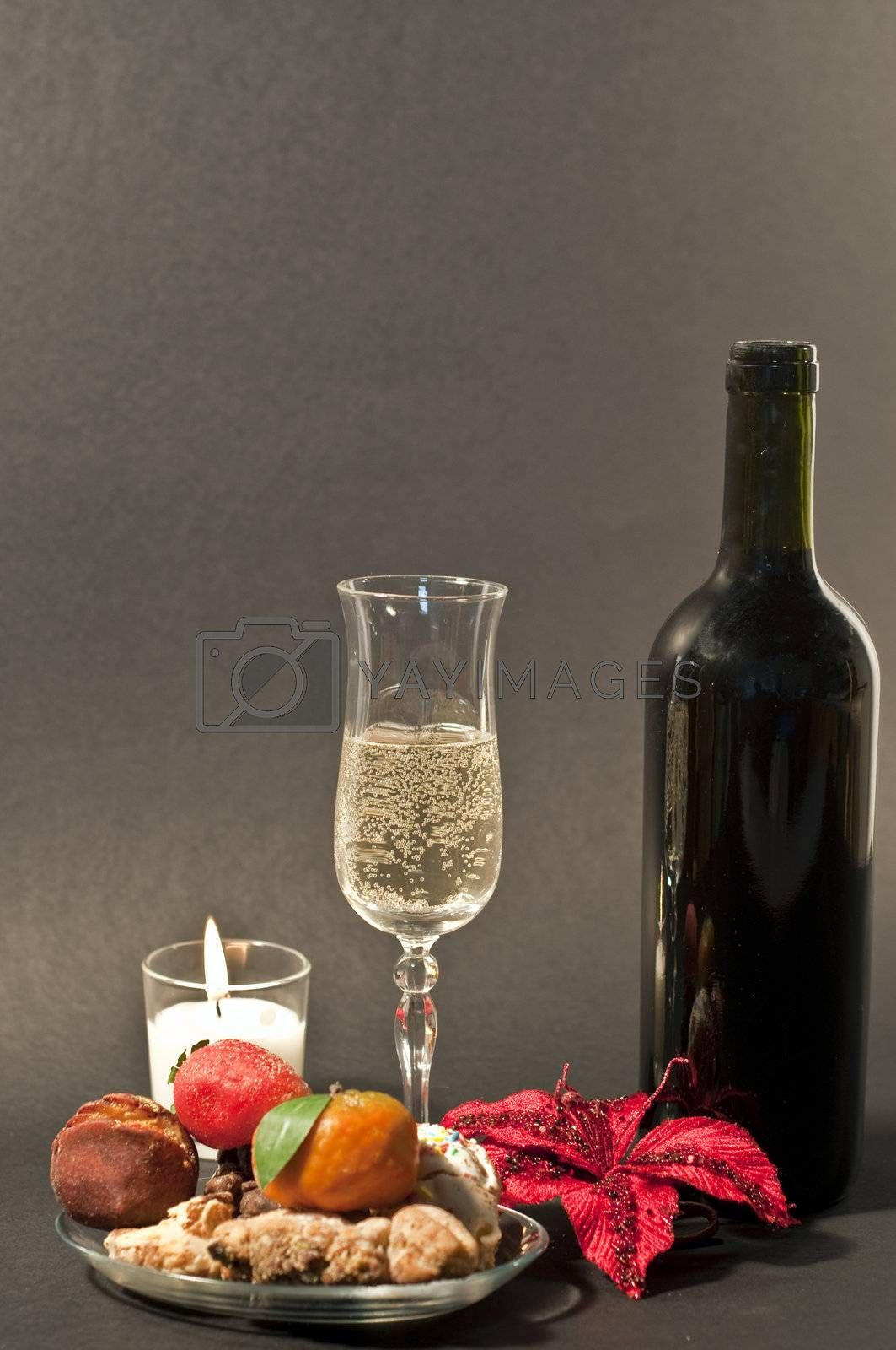Christmas composition with sweet Sicilian wine and candles