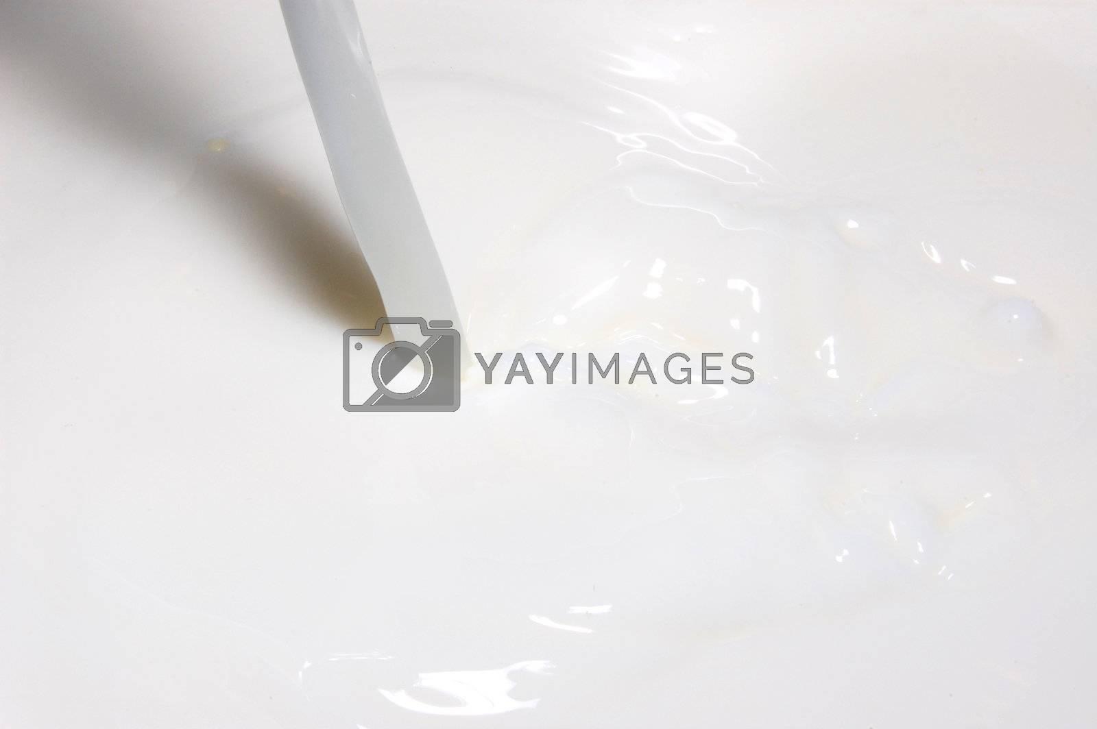 milk splashing into fresh milk with drops