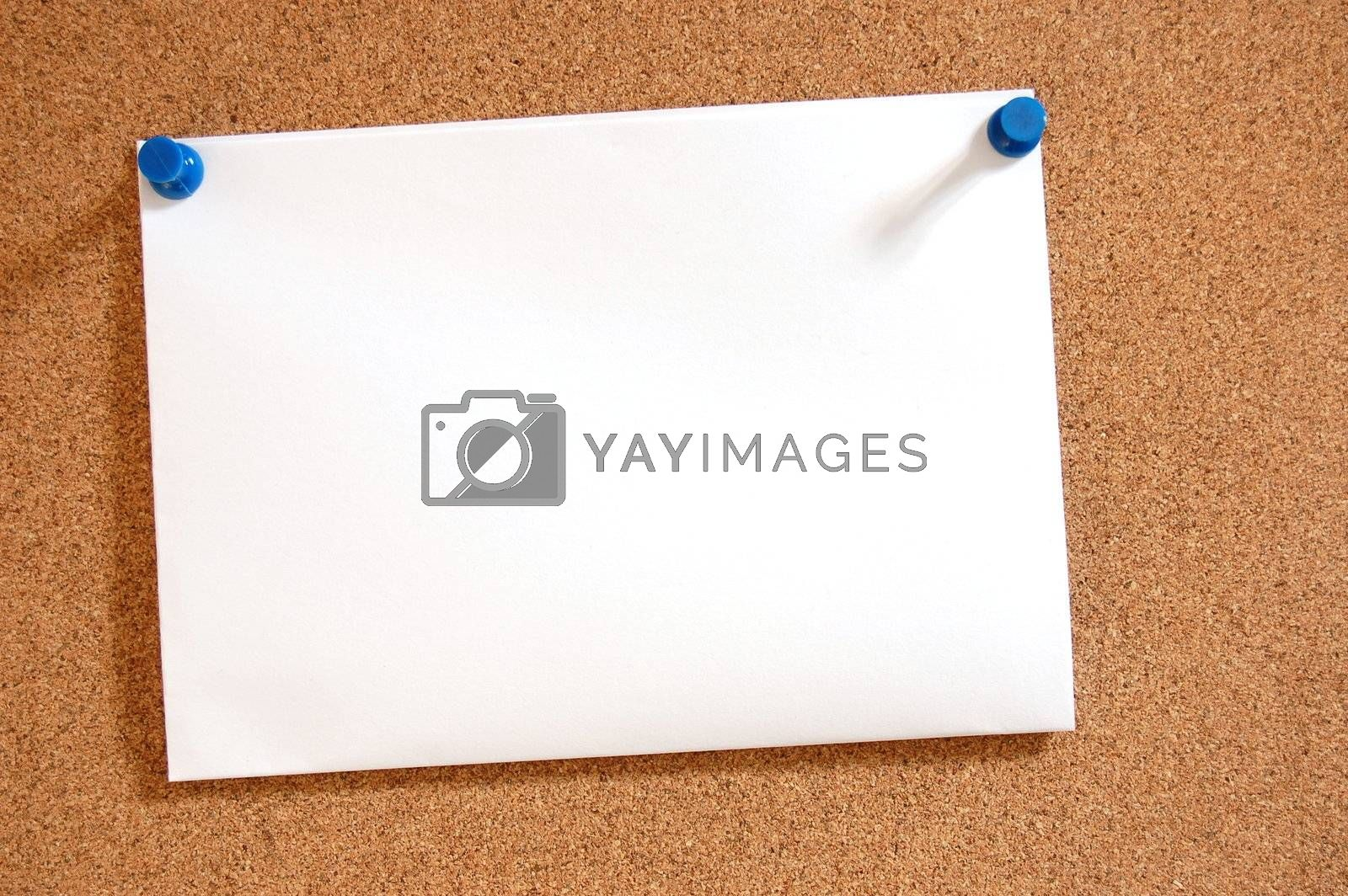 blank and empty sheet paper with copyspace on bulletin board in office