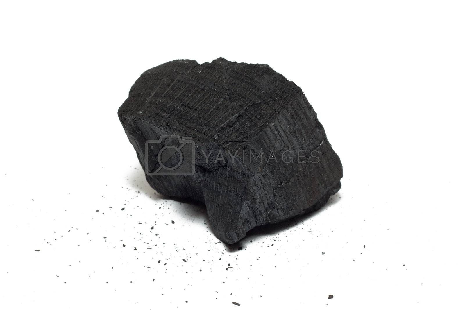 Bit of charcoal isolated on white with crums around
