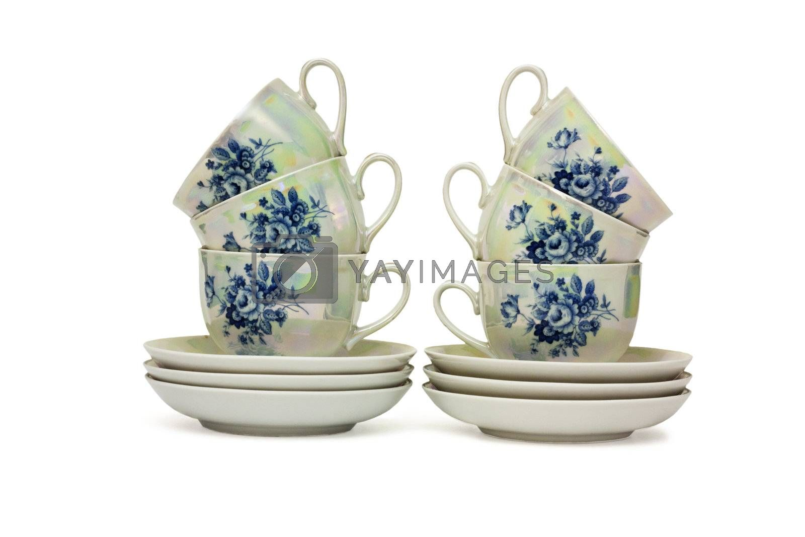 Service with six cups and saucers isolated on white