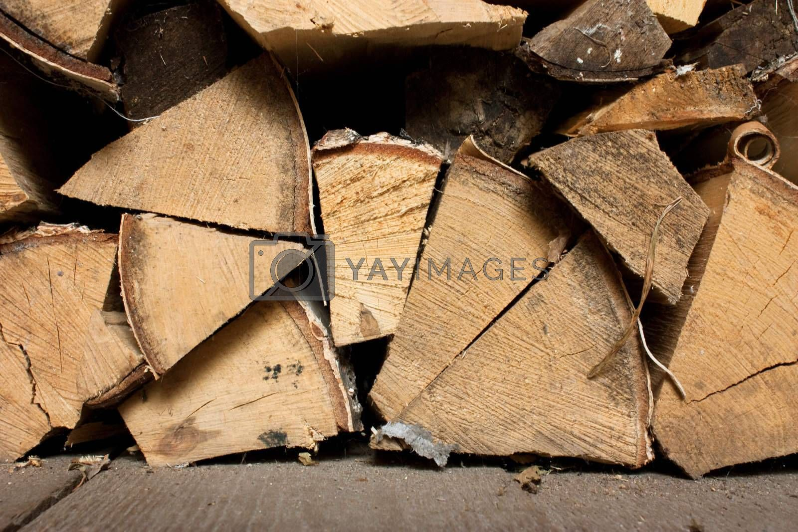 Stack of chopped firewood prepared for burning. End view.