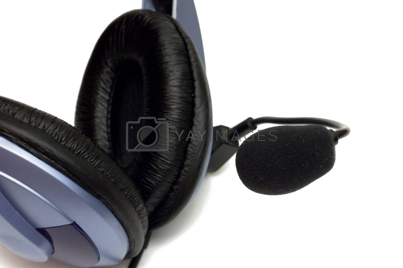 Close up image. Soft black pad of headphones and microphone isolated on white.